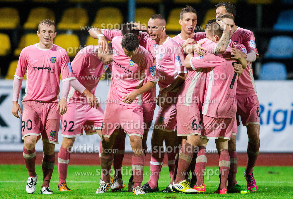 Players of Domzale celebrate after scoring second goal for Domzale during football match between NK Kalcer Radomlje and NK Domzale in 8th Round of Prva liga Telekom Slovenije 2014/15, on September 13, 2014 in Sports park Domzale, Slovenia. Photo by Vid Ponikvar  / Sportida.com
