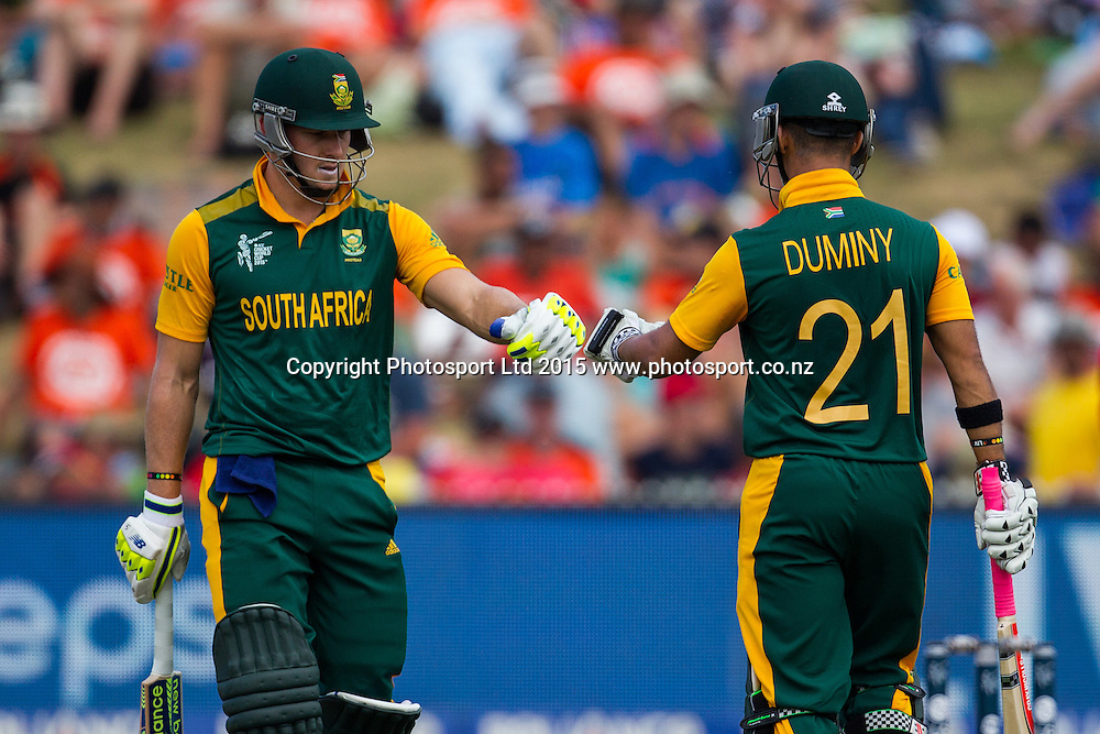 South Africa's David Miller and JP Duminy during the ICC Cricket World Cup match - South Africa v Zimbabwe at Seddon Park, Hamilton, New Zealand on Sunday 15 February 2015.  Photo:  Bruce Lim / www.photosport.co.nz