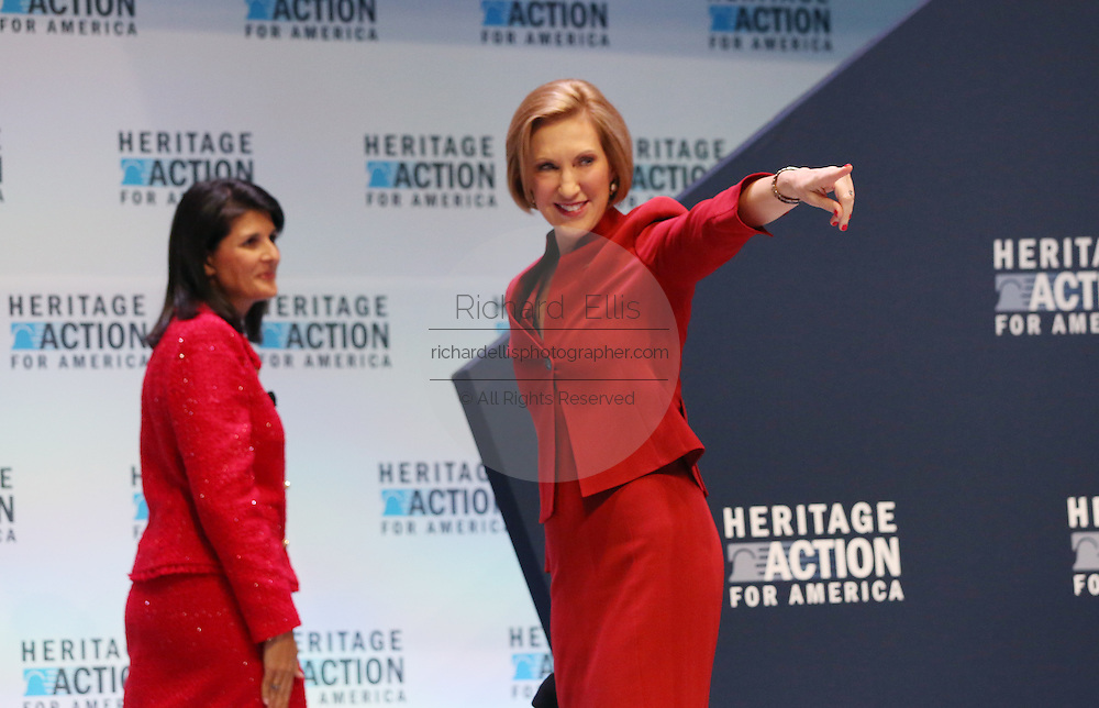 Republican presidential candidate and former CEO Carly Fiorina thanks the audience as she walks off stage with SC Gov Nikki Haley at the Heritage Foundation Take Back America candidate forum September 18, 2015 in Greenville, South Carolina. The event features 11 presidential candidates but Trump unexpectedly cancelled at the last minute.