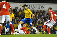 Photo: Ed Godden.<br /> Brazil v Wales. International Friendly. 05/09/2006.<br /> Brazil's Kaka (centre) escapes the challenge from Ryan Giggs (in the background).