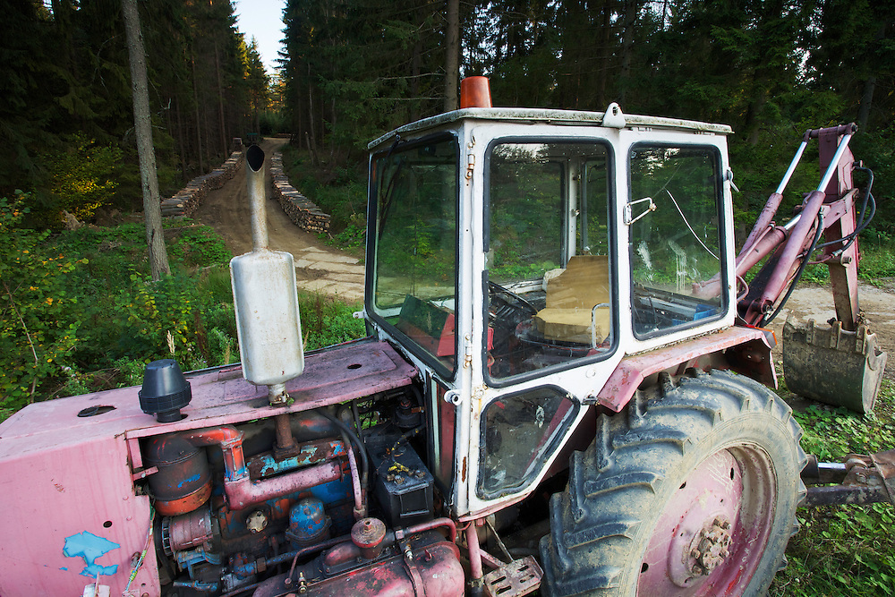 Tractor used for pulling cut logs of Scot's pine (Pinus silvestris), Birch (Betula sp.) and Common beech (Fagus sylvatica) at a state forestry woodyard at the Polish-Slovakian border, Poland.