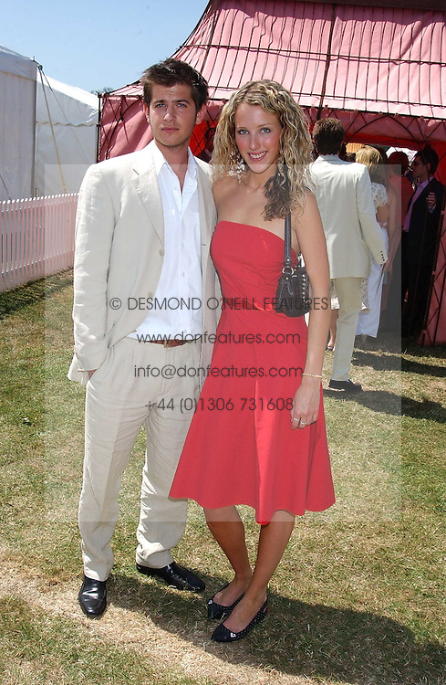 KATE MELHUISH and JACK FREUD at the Veuve Clicquot sponsored Gold Cup Final or the British Open Polo Championship held at Cowdray Park, West Sussex on 17th July 2005.<br /><br />NON EXCLUSIVE - WORLD RIGHTS