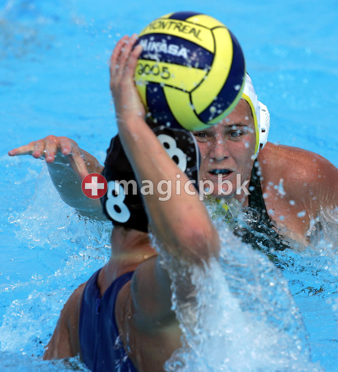 Australia's Bonwen Know (R) moves in on the Netherlands' Noeki Klein (L) during the preliminary round women's water polo at the FINA World Championships in Montreal, Quebec Thursday 21 July, 2005. Australia defeated the Netherlands 9-2. (Photo by Patrick B. Kraemer / MAGICPBK)
