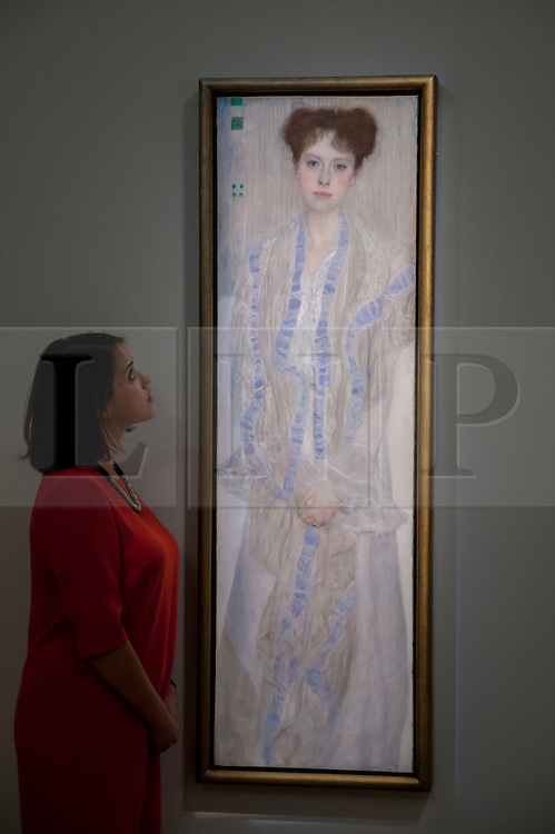 "© Licensed to London News Pictures. 19/06/2015. London, UK. A Sotheby's staff member looks at Gustav Klimt's ""Bildnis Gertud Loew"" (est. £12m - £18m), at Sotheby's Impressionist, Modern & Contemporary Art preview, ahead of the sale on 24 June 2015. Leading the sale are Kazimir Malevich's, ""Suprematism, 18th Construction"" and Edouard Manet's ""Le Bar aux Folies-Bergère"".  Photo credit : Stephen Chung/LNP"