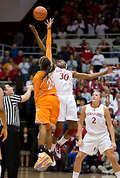 December 19, 2009; Stanford, CA, USA;  Stanford Cardinal forward Nnemkadi Ogwumike (30) and Tennessee Lady Volunteers forward Glory Johnson (25) battle for the opening tip during the first half at Maples Pavilion.  Stanford defeated Tennessee 67-52.