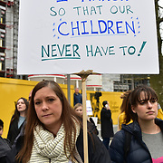 Hundreds of Americans hold a protest against guns shooting at US. Protestors demand to change the constitution and regulated. Sadly the 18th Century the wild wild west long is gone. Why can't the Americans move on?  to regulate 21st Century law. I believe most protests don't want the guns equally ignorant people to want guns law to protect the rights from who. and no one really has an answer, In fact, are in denial on 24th March 2018 outside US Embassy, London, UK.
