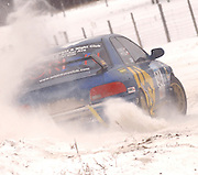 Piotr Fetela lays on the gas to escape the deeper snow after sliding through the final turn of a the fifteenth stage of the 2010 Sno-Drift road rally just ouside Atlanta, MI.  Fetela and his partner Raivo Vambuts were competing in the Drtift regional rally that was a part of the larger event.