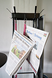 newspapers on stand in cafe at Bauhaus Building and architecture school designed by  Walter Gropius  in Dessau Germany
