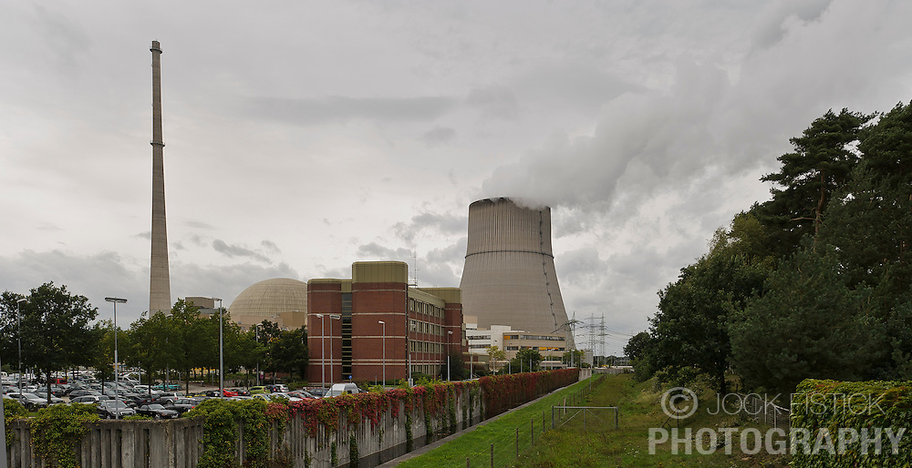 Steam billows from the cooling tower at the RWE nuclear power plant, in Lingen, Germany, on Tuesday, Sept. 6, 2011. The domed building to the left of the cooling tower houses the nuclear reactor. (Photo © Jock Fistick)