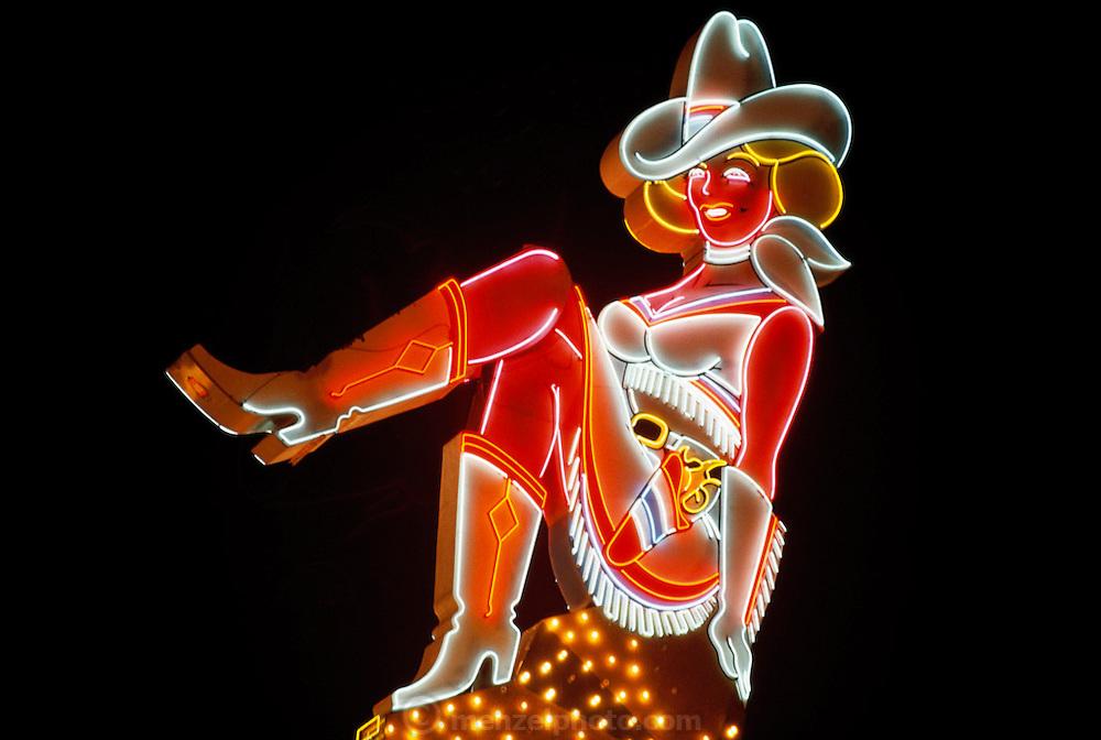 Neon Cowgirl sign, Downtown Las Vegas, Nevada. USA.