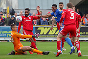 Accrington Stanley goalkeeper Dimitar Evtimov (30) saving from AFC Wimbledon defender Paul Kalambayi (30) during the EFL Sky Bet League 1 match between AFC Wimbledon and Accrington Stanley at the Cherry Red Records Stadium, Kingston, England on 6 April 2019.