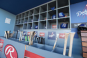 LOS ANGELES, CA - JUNE 17:  Bats, batting helmets, and batting gloves are stored in dugout bins during batting practice before the Los Angeles Dodgers game against the Colorado Rockies at Dodger Stadium on Tuesday, June 17, 2014 in Los Angeles, California. The Dodgers won the game 4-2. (Photo by Paul Spinelli/MLB Photos via Getty Images)
