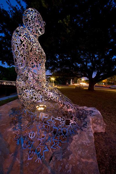 Stock photo of Artist Jaume Plensa's Tolerance sculptures on Allen Parkway in Houston Texas at night