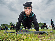 17 JUNE 2015 - RANGAE, NARATHIWAT, THAILAND:  A Thai woman Ranger does pushup during drills at the Ranger camp in Rangae, Narathiwat province. There are 5 platoons of women Rangers serving in Thailand's restive Deep South. They generally perform security missions at large public events and do public outreach missions, like home wellness checks and delivering food and medicine into rural communities. The medics frequently work in civilian clothes because the Rangers found people are more relaxed around them when they're in civilian clothes. About 6,000 people have been killed in sectarian violence in Thailand's three southern provinces of Narathiwat, Pattani and Yala since a Muslim insurgency started in 2004. Attacks usually spike during religious holidays. Insurgents are fighting for more autonomy from the central government in Bangkok.    PHOTO BY JACK KURTZ