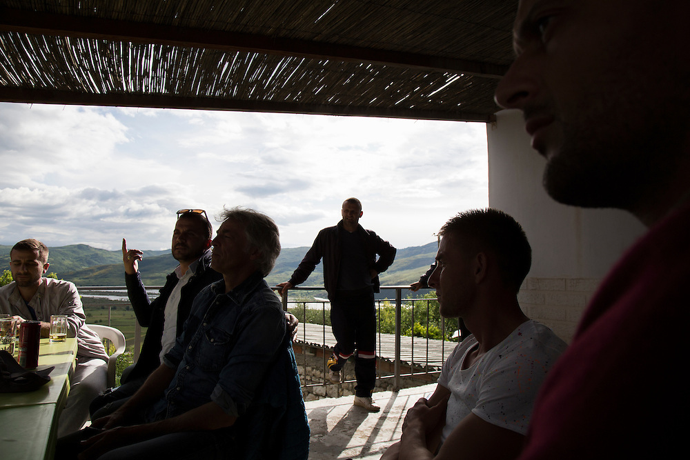 A villager in Kuta talks about the dam with Ulrich Eichelmann, founder of River Watch, a non-governmental organization working to preserve and save undammed rivers from hydropower projects.