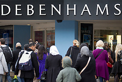 © Licensed to London News Pictures. 08/01/2013. London, UK.  Shoppers walk past Debenham's flagship Oxford Street store in London today (08/01/13).  The department store chain today reported record December sales, achieved in part by additional promotions, with like-for-like sales rising by 2.9% compared to the same period in 2011/12 and online sales boosted by 39%.  Photo credit: Matt Cetti-Roberts/LNP