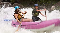 Unidentified whitewater rafters power their raft through the rapids at Pillow Rock on the Gauley River during American Whitewater's Gauley Fest weekend. The upper Gauley, located in the Gauley River National Recreation Area is considered one of premier whitewater rivers in the country.
