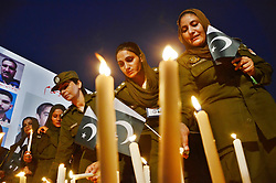 August 4, 2017 - Lahore, Punjab, Pakistan - Female Pakistani Police and other police officials light the candles at Yadgar-e-Shuhada, for police martyrdom day, to pay homage to martyrs of Police laying their lives for defense of motherland in Lahore. (Credit Image: © Rana Sajid Hussain/Pacific Press via ZUMA Wire)