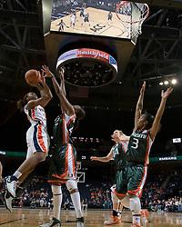 Virginia Cavaliers Guard Monica Wright (22) shoots over Miami Hurricanes center Carla Williams (42).  The University of Virginia Cavaliers defeated the Miami Hurricanes Women's Basketball Team 73-60 at the John Paul Jones Arena in Charlottesville, VA on February 4, 2007.