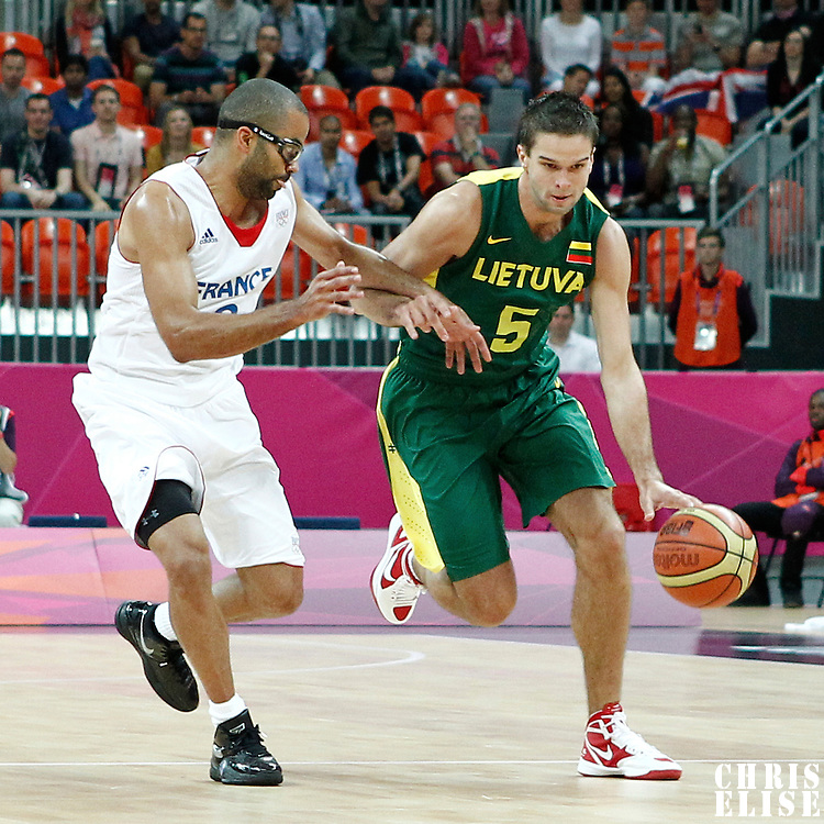 02 August 2012: Lithuania Mantas Kalnietis drives past Tony Parker during 82-74 Team France victory over Team Lithuania, during the men's basketball preliminary, at the Basketball Arena, in London, Great Britain.