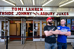 Supporters of Tomi Lahren face off with a group of protestors across the street, ahead of a tour stop by conservative political commentator and Fox News contributor, at the Keswick Theatre in Glenside, PA on May 17, 2018.
