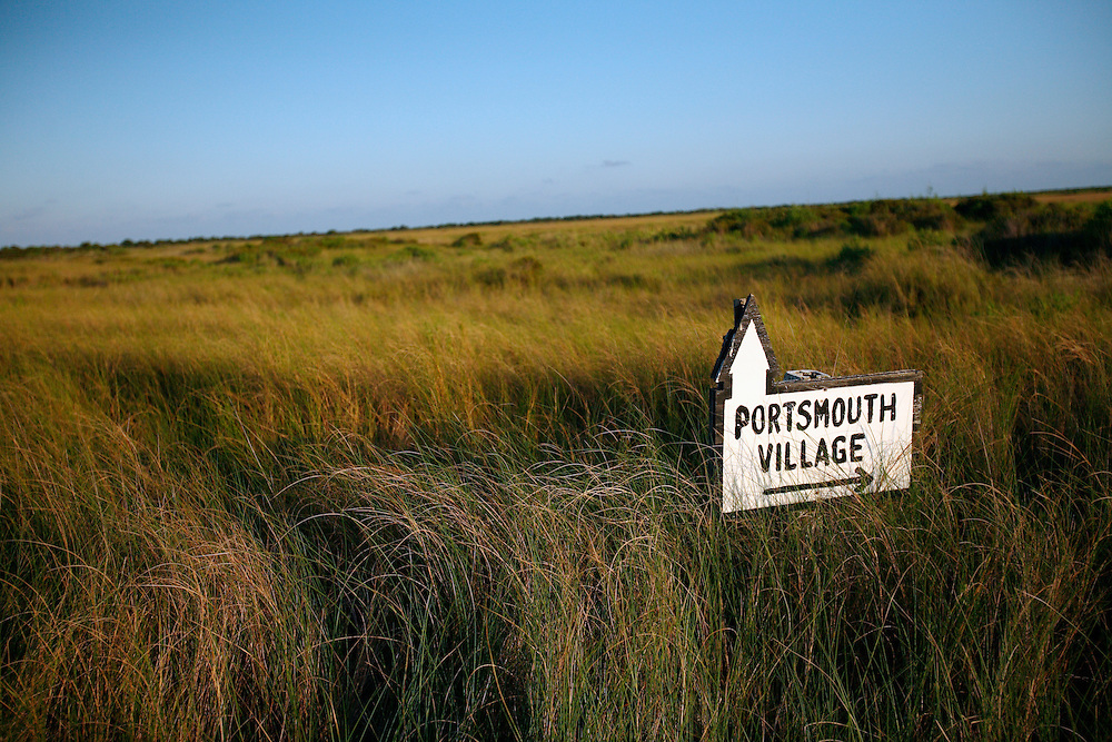 A sign shows the way to Portsmouth Village on Portsmouth Island, NC. Located in the North Core Banks, just southwest of  Ocracoke Island. Portsmouth Village was established by North Carolina's Colonial Assembly in 1753, but the village's last permanent residents left in 1971. It came under ownership of the National Park Service as part of the Cape Lookout National Seashore in 1976.