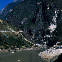 Kayakers approach Tiger Leaping Gorge beneath Jade Dragon Mountain, 1999 Mild Seven Outdoor Quest Adventure Race, Lijiang, China