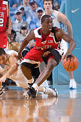 28 December 2006: Rutgers guard (1) Marquis Webb pressured by guard (22) Wes Miller during a 87-48 Rutgers Scarlet Knights loss to the North Carolina Tarheels, in the Dean Smith Center in Chapel Hill, NC.<br />
