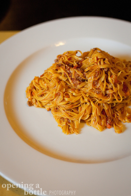 Tajarin al ragu (pasta with meat sauce), a staple of Piemontese cuisine, as served in a restaurant in La Morra, Italy.