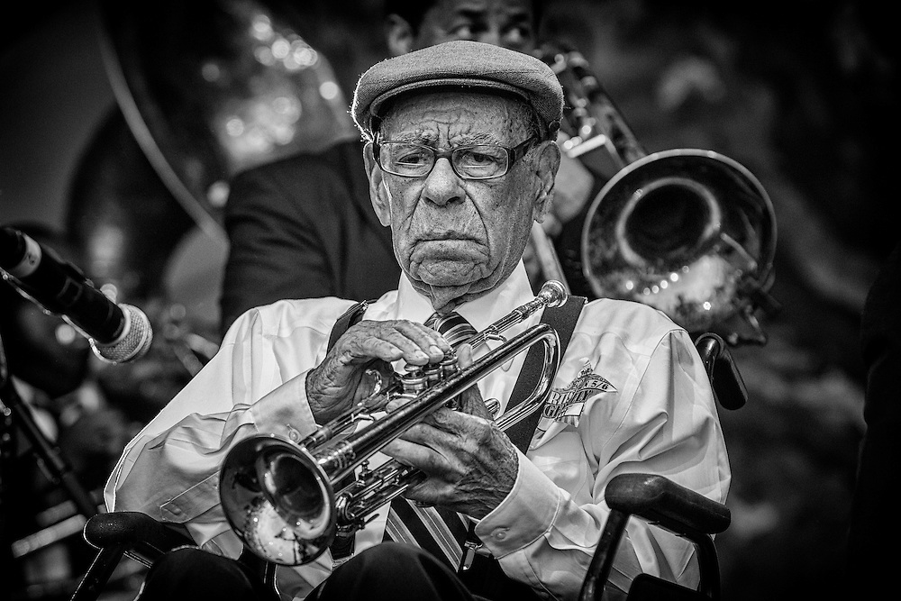 At 100, New Orleans oldest jazz musician, trumpeter Lionel Charles Ferbos performs on stage for the Preservation Hall and Friends 50th Anniversary Celebration during the 2012 New Orleans Jazz & Heritage Festival at the Fair Grounds Race Course on May 6, 2012 in New Orleans, Louisiana.
