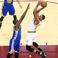 10 June 2016: Cleveland Cavaliers center Tristan Thompson (13) goes for the jump shot over Golden State Warriors forward Draymond Green (23) during the Golden State Warriors 108-97 victory over the Cleveland Cavaliers, during Game Four of the 2016 NBA Finals at the Quicken Loans Arena, Cleveland, Ohio, USA.