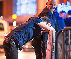 © Licensed to London News Pictures . 01/01/2016 . Manchester , UK . A man vomits copiously . Revellers in Manchester on a New Year night out at the clubs around the city centre's Printworks venue . Photo credit : Joel Goodman/LNP