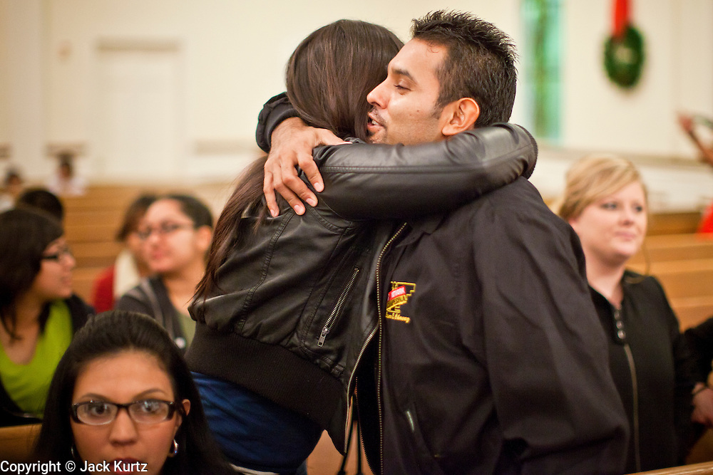 19 DECEMBER 2010 - PHOENIX, AZ: Supporters of the DREAM Act greet each other before a prayer service in Phoenix. About 100 supporters of the DREAM Act gathered at First Congregational Church of Christ in Phoenix Sunday night, December 19, for a prayer vigil in support of the DREAM Act, which was defeated in the US Senate Saturday, Dec. 18. The DREAM Act, was supported by the Obama administration, and was an important part of the administration's immigration reform platform. The defeat of the DREAM Act, which would have established a path to citizenship for undocumented immigrants who were brought to the US by their parents when they were children, set back the President's immigration reform efforts.   PHOTO BY JACK KURTZ