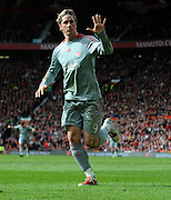 Fernando Torres of Liverpool celebrates scoring during the Barclays Premier League match between Manchester United and Liverpool at Old Trafford on March 14, 2009 in Manchester, England.