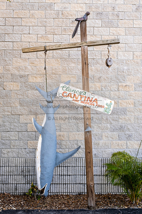A shark model hanging at a restaurant in the historic Flagler Avenue shopping district in New Smyrna Beach, Florida. New Smyrna Beach is known as the shark attack capital of North America due to the high number of shark bites along the beaches.