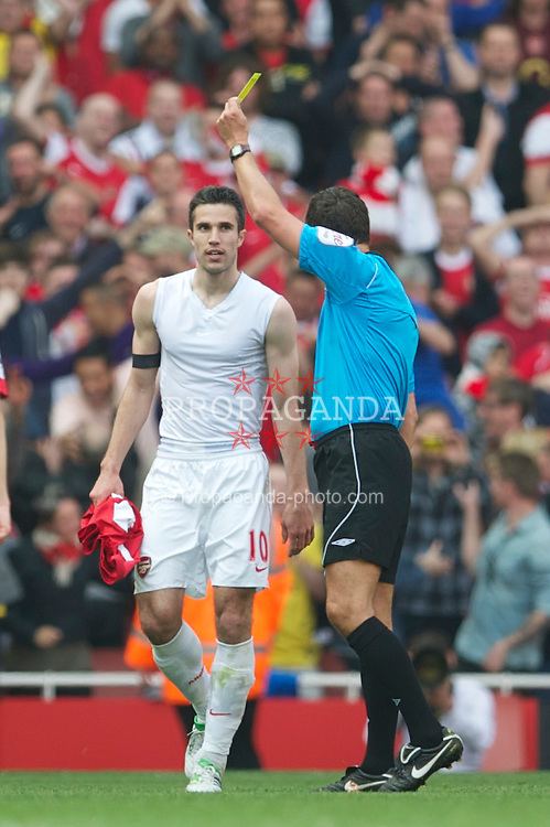 LONDON, ENGLAND - Sunday, April 17, 2011: Arsenal's Robin Van Persie is shown the yellow card by referee Andre Mariner after removing his shirt to celebrates scoring the opening goal against Liverpool during the Premiership match at the Emirates Stadium. (Photo by David Rawcliffe/Propaganda)