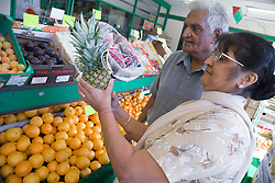 Older couple out shopping for fruit,