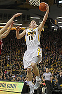 December 31 2012: Iowa Hawkeyes guard Mike Gesell (10) drives to the basket for a layup during the first half of the NCAA basketball game between the Indiana Hoosiers and the Iowa Hawkeyes at Carver-Hawkeye Arena in Iowa City, Iowa on Monday December 31, 2012. Indiana defeated Iowa 69-65.