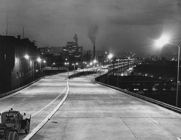 Engineers turned on lights of the Alaskan Way viaduct for the first time last night. This photograph, looking south along the viaduct's upper deck from a point near Bell Street, shows how the new structure will look at night. (George Carkonen / The Seattle Times)