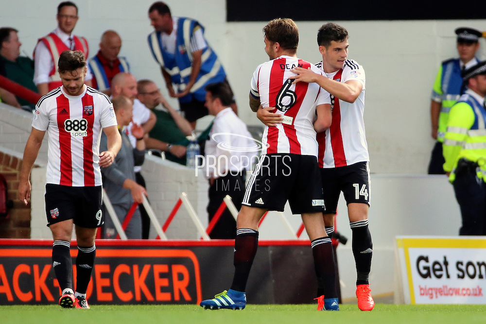 Brentford defender John Egan (14)  celebrating with Brentford defender Harlee Dean (6)  2-0 during the EFL Sky Bet Championship match between Brentford and Ipswich Town at Griffin Park, London, England on 13 August 2016. Photo by Matthew Redman.