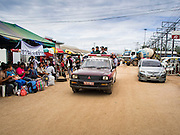 09 JULY 2014 - ARANYAPRATHET, SA KAEO, THAILAND:  Cambodian migrants are given a ride to the immigration station in Aranyaprathet by Thai police. The Thai government has opened a One Stop Service Center in Aranyaprathet on the Thai-Cambodian border. More than 200,000 Cambodian migrant workers, most undocumented, fled Thailand in early June fearing a crackdown by Thai authorities after a coup unseated the elected government. Employers have been unable to fill the vacancies created by the Cambodian exodus and the Thai government has allowed them to return. The Cambodian workers have to have a job and their employers have to vouch for them. The Thai government is issuing temporary ID cards to allow them to travel openly to their jobs. About 800 Cambodian workers came back to Thailand through the Aranyaprathet border crossing Wednesday. The Thai government has opening similar service centers at three other crossing points on the Thai-Cambodian border.   PHOTO BY JACK KURTZ