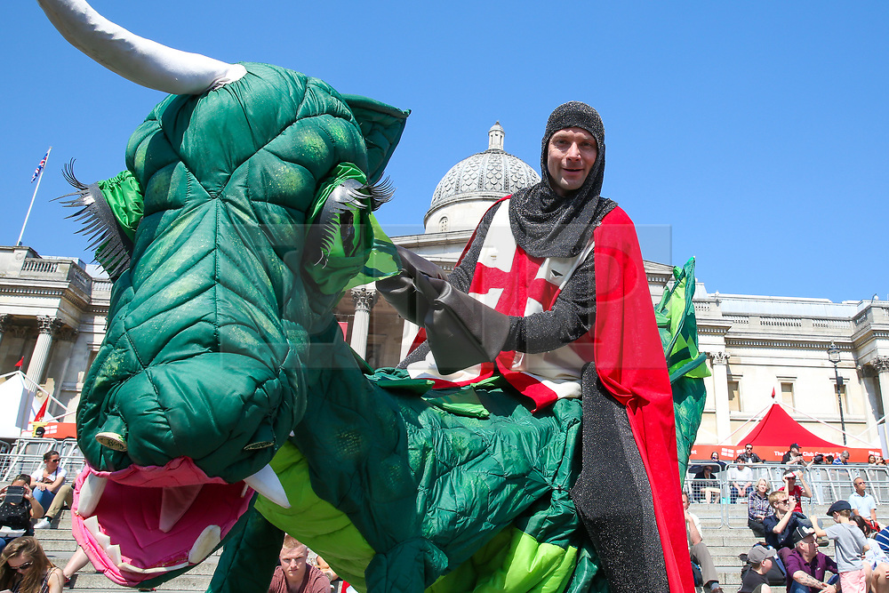 © Licensed to London News Pictures. 20/04/2019. London, UK. A man dressed as St George on a dragon attends the annual 'Feast of St George' event in Trafalgar Square, to celebrate the Patron Saint of England. St George's Day is on 23 April.  Photo credit: Dinendra Haria/LNP