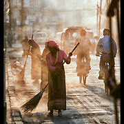 Women gather to sweep the street of Katmandu, Nepal.