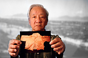Apr. 07, 2011; Hiroshima, Japan - Ernest Arai holds up a photo of the t-shirt he was wearing when the bomb detonated. The t-shirt is now part of the Hiroshima Peace Memorial Museum's permanent archives.<br /> Project Hibakusha : Hope for Peace