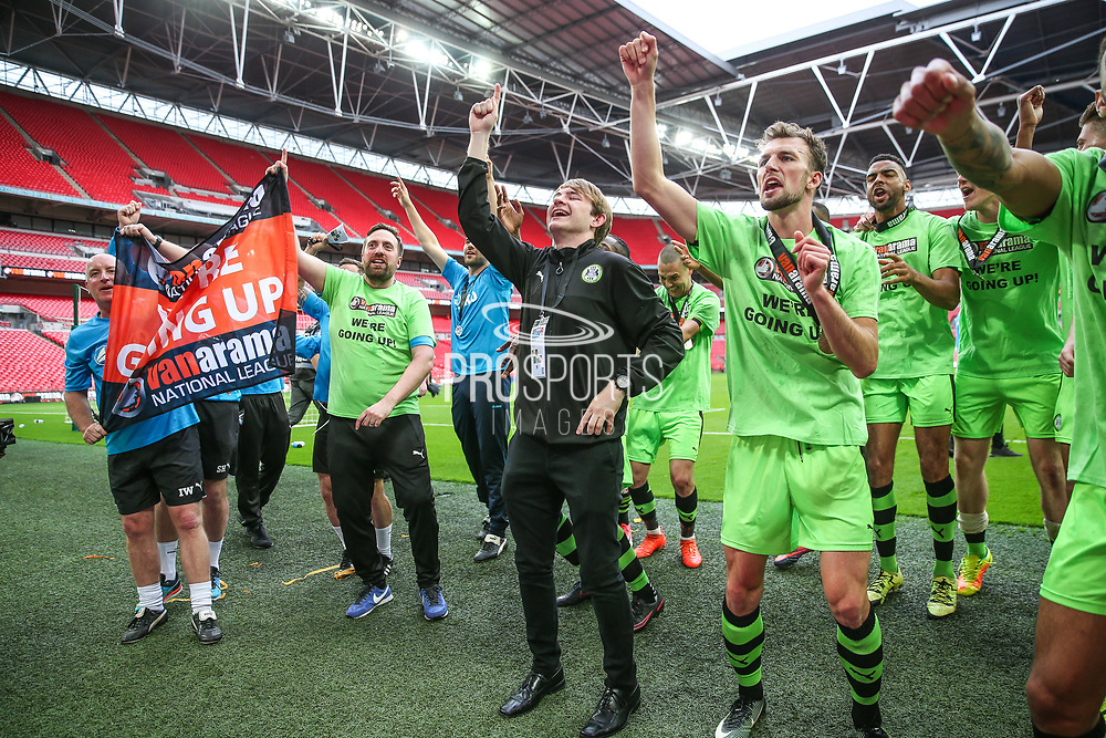 FGR press officer Richard Joyce joins in with Forest Green Rovers Christian Doidge(9) celebrating during the Vanarama National League Play Off Final match between Tranmere Rovers and Forest Green Rovers at Wembley Stadium, London, England on 14 May 2017. Photo by Shane Healey.