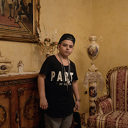 Luciano Ferrara, 8 years old, in the living room of his house in Frignano.