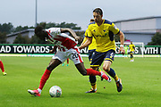 Mohamed Eisa and Aaron Martin during the EFL Cup match between Oxford United and Cheltenham Town at the Kassam Stadium, Oxford, England on 8 August 2017. Photo by Antony Thompson.
