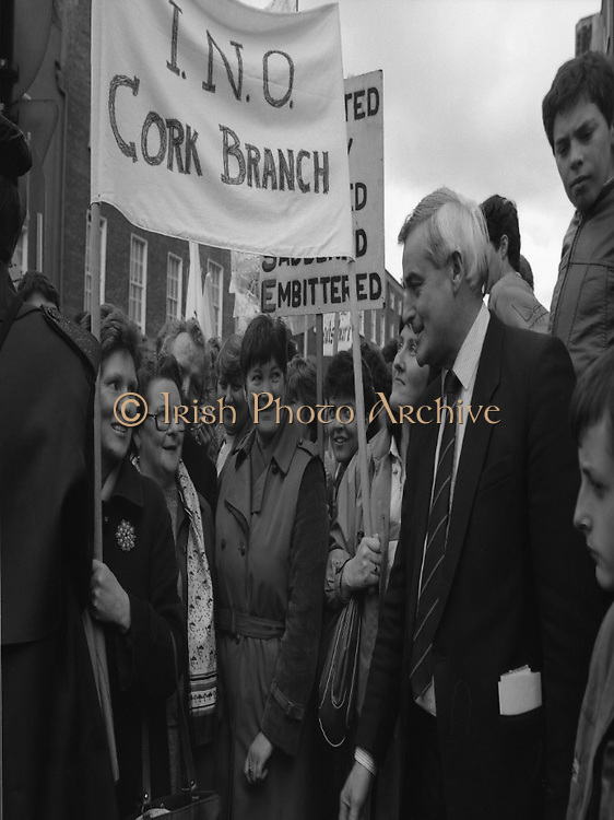 Irish Nurses Organisation Protest..28.05.1986..05.28.1986..28th May 1986..In protest against proposed health cuts the Irish Nurses Organisation organised a protest march to Dail Eireann. Nurses from all over Ireland were represented at the march...Dail Deputy Mr Ned O'Keefe, from Cork, pictured speaking to the nurses ,from Cork, taking part in the protest march. Nurses included Tess Hogan,Maura Cadogan,Seamus McKenna,Phil Hogan and Helen Flynn.