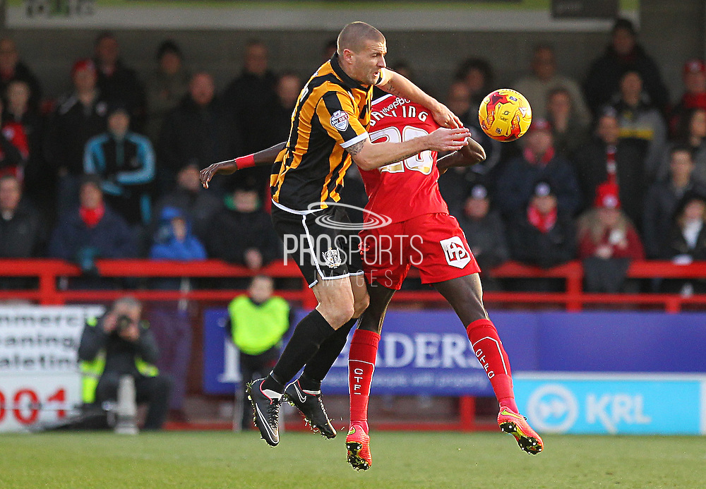 Port Vale's Carl Dickinson wins the ball in the air during the Sky Bet League 1 match between Crawley Town and Port Vale at Broadfield Stadium, Crawley, England on 20 December 2014. Photo by Phil Duncan.