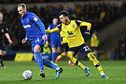 AFC Wimbledon midfielder Mitchell Pinnock (11) battles for possession  with Oxford United forward (on loan from West Ham United) Nathan Holland (27) during the EFL Sky Bet League 1 match between Oxford United and AFC Wimbledon at the Kassam Stadium, Oxford, England on 18 February 2020.